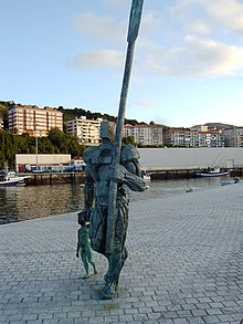 Statue of a man carrying a large oar