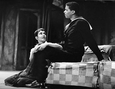 "A Taste of Honey is an influential ""kitchen sink drama"". In this photo of the 1960 Broadway production, Joan Plowright plays the role of Jo, a 17-year-old schoolgirl who has a love affair with a black sailor (played by Billy Dee Williams)."