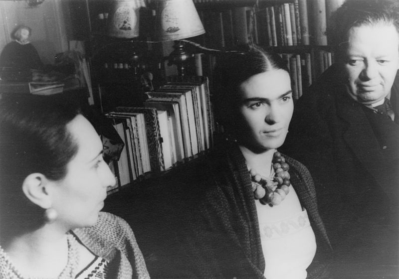 Frida Kahlo sitting between two other people