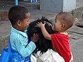 Boys Tousle Brother's Hair in Street - Pyin Oo Lwin - Myanmar (Burma) (12028809904).jpg