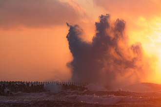 Wind power in Denmark - Breaking waves at the north sea coast of Denmark in the evening of July 9, 2015 as the new record in peak capacity was reached.