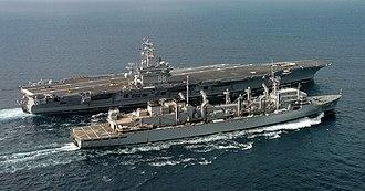 USNS Bridge (T-AOE-10) - USNS Bridge replenishing USS Nimitz at sea in February 2006