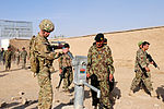 Brig. Gen. Sinclair examines water pump in Zharay district DVIDS489690.jpg