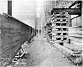 Building supports in alley next to the Smith Tower construction site, Seattle, Washington, January 3, 1912 (SEATTLE 4874).jpg