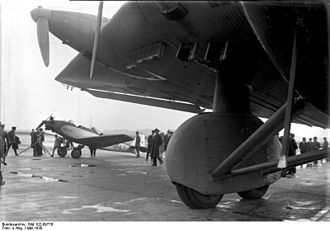 "Junkers G.38 -  First prototype at Berlin Tempelhof Airport showing spatted tandem main wheels, the aileron section of the ""double wing"" and—most unusually—retractable oil and water radiators"