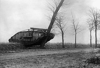 Tanks in the British Army - A German propaganda photograph showing a British tank destroying a tree