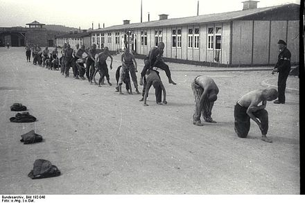 Gruelling and pointless physical exercise was one of the methods of &quotwearing the inmates down&quot.[36] Here a group of prisoners are forced to play &quotleap frog&quot. - Mauthausen-Gusen concentration camp