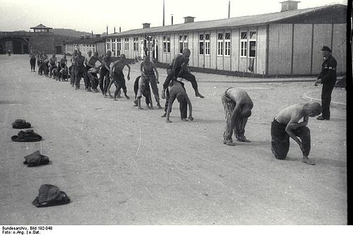 Gruelling and pointless physical exercise was one of the methods of &quotwearing the inmates down&quot.[20] Here a group of prisoners are forced to play &quotleap frog&quot. - Mauthausen-Gusen concentration camp