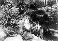 COLLECTIE TROPENMUSEUM Pastoor met misdienaar te paard opweg naar afgelegen kampong voor bediening Flores TMnr 10000695.jpg