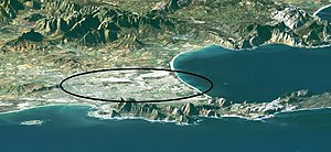 Cape Flats -  Landsat image of Cape Town and environs, looking roughly east. Cape Peninsula in the foreground; Table Bay with Robben Island to the left; False Bay with Seal Island (small white dot) to the right. The mountains of the Boland to the rear. The oval (long axis about 25km) roughly encompasses the Cape Flats.