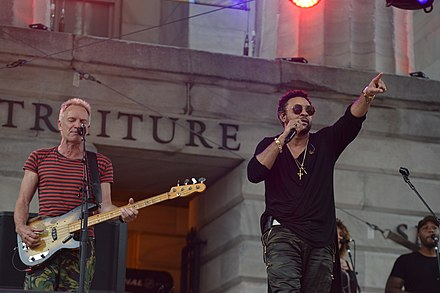 Sting (left) performing with Shaggy (right) at the 2018 Capitals playoff concert Capitals All Caps playoff Concert 2018 (42059410904).jpg