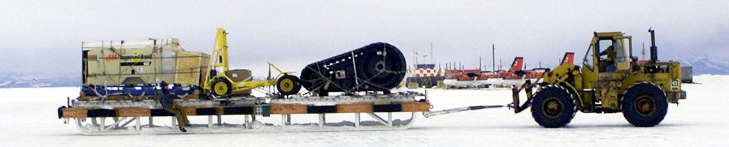 "A 10K-AT ""All Terrain"" forklift moves a loaded cargo-sled as part of an Operation Deep Freeze resupply mission Cargo sled, McMurdo Station (cropped).JPEG"