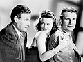 Cat People promotional still - Tom Conway, Simone Simon, and Kent Smith.jpg