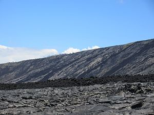 Chain of Craters Road - Lava continues to change the landscape. The hillside flows date from the 1969-74 Mauna Ulu eruptions. The foreground pahoehoe lava is from the 2003 flow.