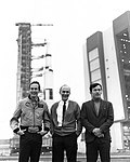 Charlie Duke (left), TK Mattingly, and John Young pose in front of the VAB during the second rollout.jpg