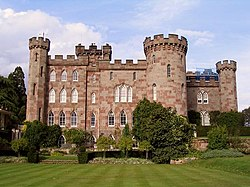 A country house with appearance of a castle with towers and battlements