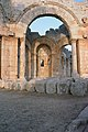 Church of Saint Simeon Stylites, Qalat Sem'an Complex (قلعة سمعان), Syria - Pier arch in octagon with trapezoidal chapel in the background - PHBZ024 2016 0676 - Dumbarton Oaks.jpg