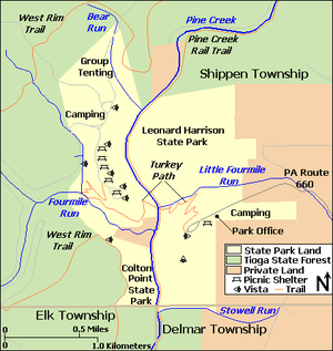 A map showing the two parks with Tioga State Forest to the north, west, and south and private land to the east. Labels include Delmar, Elk, and Shippen Townships, Pine Creek and its tributaries Bear Run, Fourmile Run, Little Fourmile Run, and Stowell Run, Pine Creek Rail Trail, West Rim Trail, Turkey Path, Pennsylvania Route 660, Park Office, and Camping and Group Tenting areas. Symbols for picnic shelters and vistas are shown in each park.