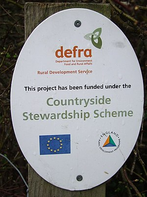 Department for Environment, Food and Rural Affairs - A Countryside Stewardship Scheme sign near a new stile a Cratfield, Suffolk