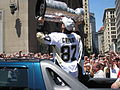 Crosby kiss the Stanley Cup (3633294209).jpg