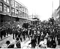 Crowd surrounding streetcar during strike against Seattle Electric Co, in front of Bon Marche, 2nd Ave and Pike St, Seattle (CURTIS 181).jpeg