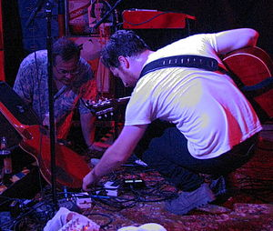 WBJB-FM - DJ Jeff Raspe helping Alex Dezen of The Damnwells with a technical problem at The Saint, September 2011
