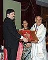 Dayanidhi Maran presenting the Shilp Guru Award 2008 to Shri Reba Kanta Mahanta from Assam for Wood & Bamboo Mask Making.jpg