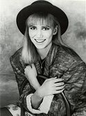 Debbie Gibson smiling towards the camera.