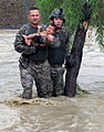 Defense.gov News Photo 100728-A-XXXXA-018 - U.S. Army Sgt. Robert Huff and Cpl. Patrick O Rourke rescue an Afghan child from encroaching flood waters in Nari Shahi village in the Beshood.jpg