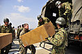 Defense.gov News Photo 110329-F-EL033-243 - A U.S. Marine 2nd from left from Combined Arms Training Center Camp Fuji Japan and Japanese Ground Self-Defense Force soldiers load boxes of.jpg