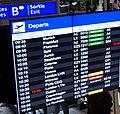 Departure board at Geneva Airport (cropped).jpg