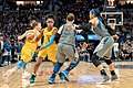 Diamond DeShields (1) defends the ball against Lindsay Whalen (13) and Maya Moore (23).jpg