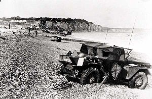 Western Front (World War II) - Dieppe's pebble beach and cliff immediately following the raid on 19 August 1942. A scout car has been abandoned