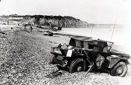Dieppe's pebble beach and cliff immediately following the raid on 19 August 1942. A scout car has been abandoned Dieppe pebble beach.jpg