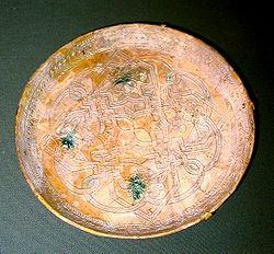 This earthenware dish was made in 9th century Iraq. It is housed in the Freer Gallery of Art of the Smithsonian Institute in Washington, D.C.
