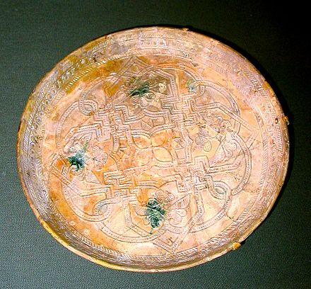 This earthenware dish from 9th century Abbasid Iraq is one of the many artifacts exhibited at the Freer Gallery. Dish from 9th century Iraq.jpg