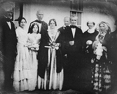 James and Sarah Polk on the portico of the White House alongside Secretary of State James Buchanan, and former first lady Dolley Madison. Dolly MAdison.jpg