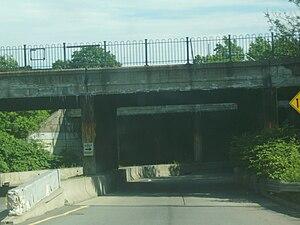 Dowd Avenue (Elizabeth, New Jersey) - Dowd Avenue heading under a state-maintained bridge in Elizabeth