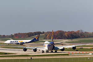 Atlas Air - A 747-8F lines up on Runway 27 at CVG as a 747-400F lands on 18C