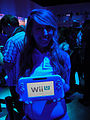 E3 2011 - Nintendo girl holding the Wii U controller (5831893934).jpg