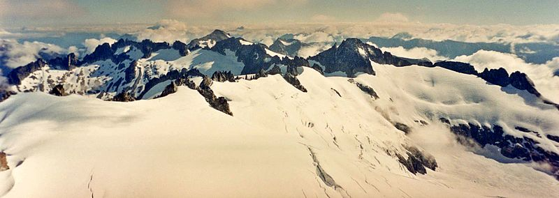 Photograph of an ice-capped mountain range covered in snow