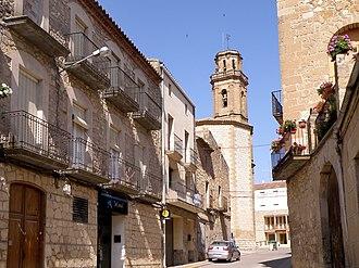 Maials - Carrer de Maials, with the church of the Assumption