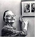 Esther Pohl Lovejoy looking at a portrait of her younger self.jpg