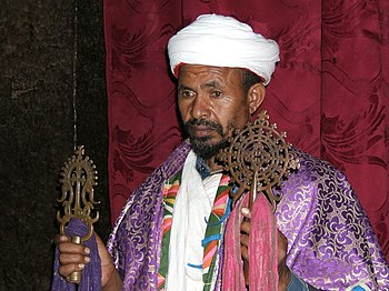 Priest with cross at Lalibela