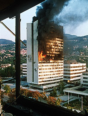 Bosnian parliament building burns after being hit by Bosnian Serb artillery. - 1990s