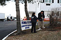 FEMA - 34364 - FEMA workers hanging a Disaster Recovery Center sign in Kentucky.jpg