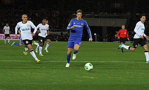 2012 FIFA Club World Cup Final - Fernando Torres being chased by Fabio Santos during the match