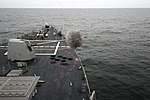 Flickr - Official U.S. Navy Imagery - Forrest Sherman fires its five-inch gun..jpg