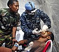 Flickr - Official U.S. Navy Imagery - US and Papua New Guinea dentists prepare to extract a tooth during Pacific Partnership 2011.jpg