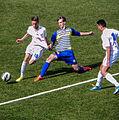 Football duel (18281341645).jpg